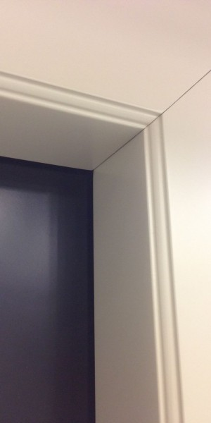 L-shaped architrave